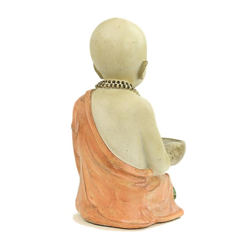 Kleiner Mönch mit Kerzenhalter